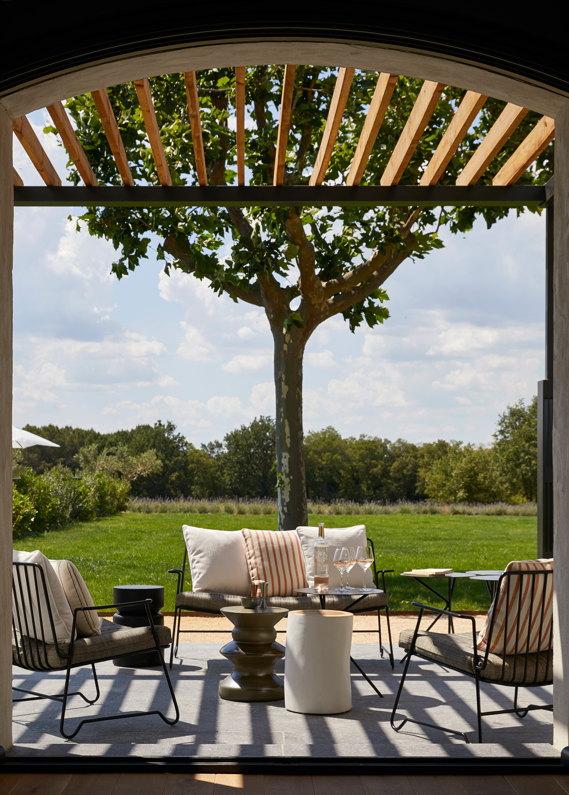 A picturesque archway, overlooking the lawns | Ultimate Provence | Humbert and Poyet | STIRworld