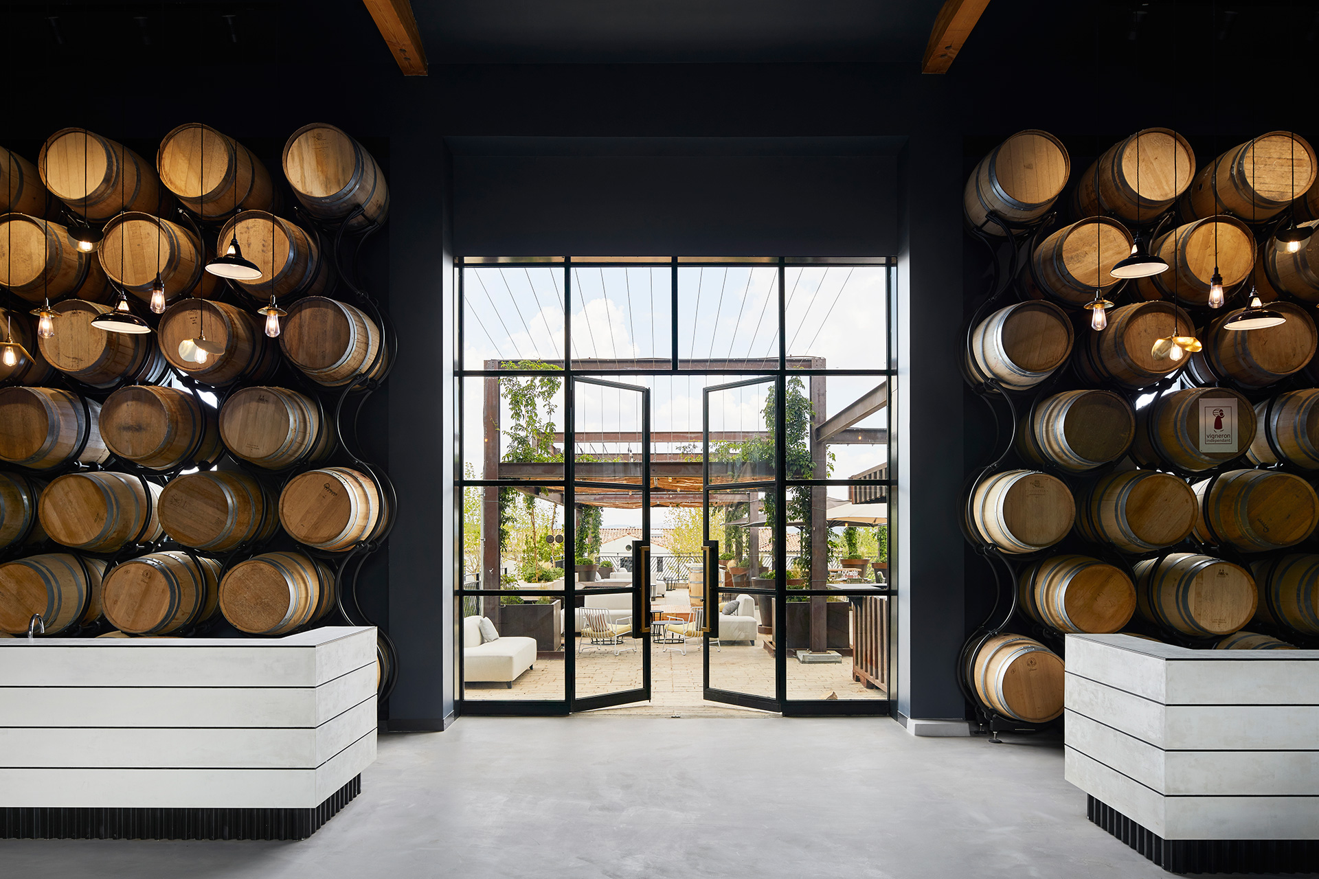 Wine barrels in a storage room at Ultimate Provence | Ultimate Provence | Humbert and Poyet | STIRworld