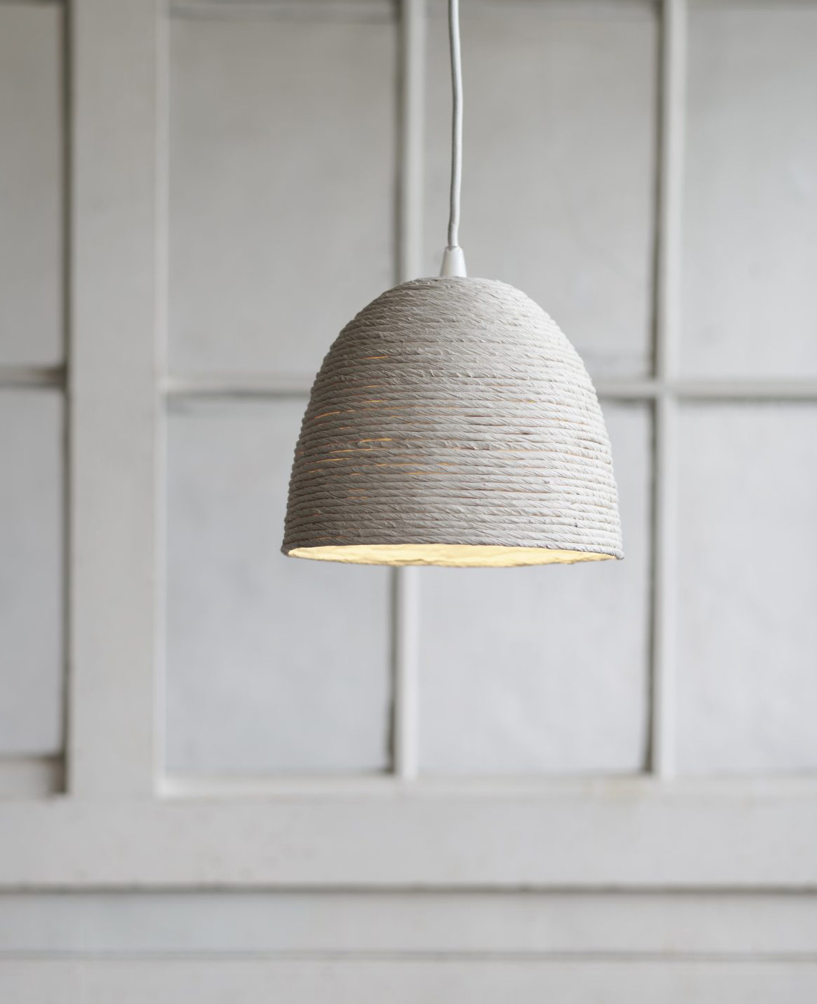A lamp shade from the FÖRÄNDRING collection made out of rice straw and fabric waste  |  Better Air Now | IKEA | STIRworld