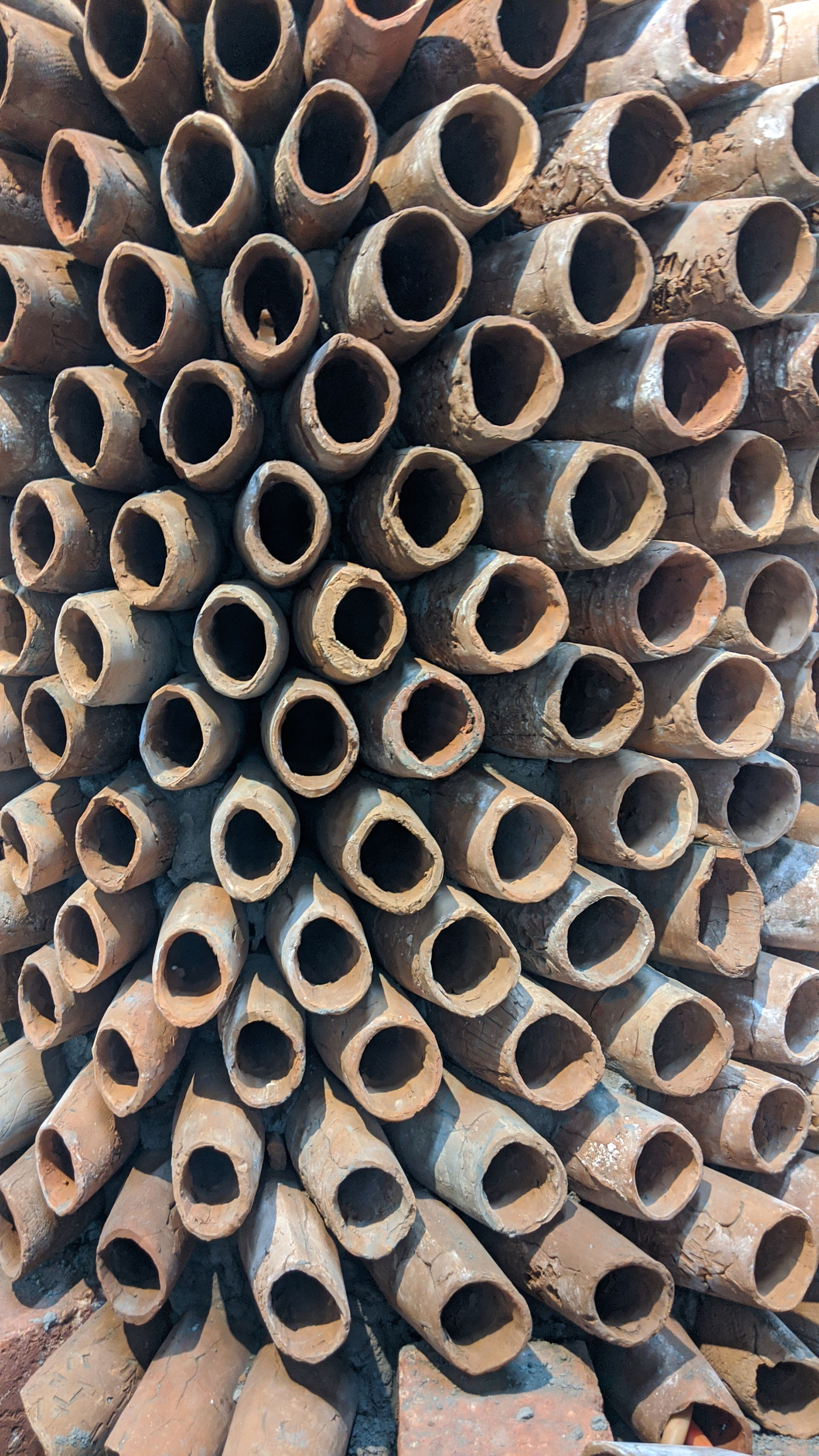 Recycled water at room temperature is allowed to run on the surface of the cylinders, cooling the hot air passing through the multiple terracotta cones | CoolAnt Coral | Ant Studio | STIRworld