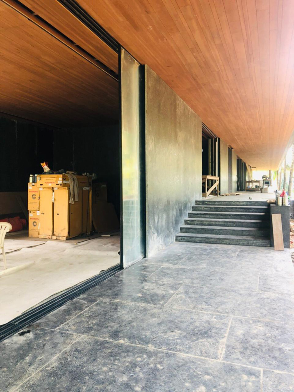 Parikrama House under construction (materials like glass, granite and wood have been used) | Parikrama House | SPASM Design Architects | STIRworld