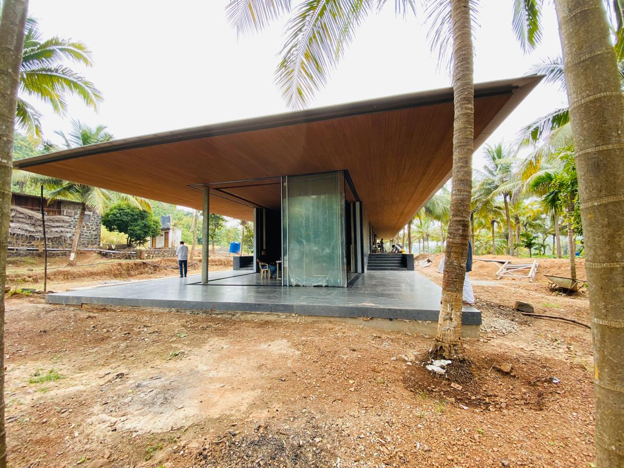 The house's roof covered in wood, floor finished in granite stone | Parikrama House | SPASM Design Architects | STIRworld