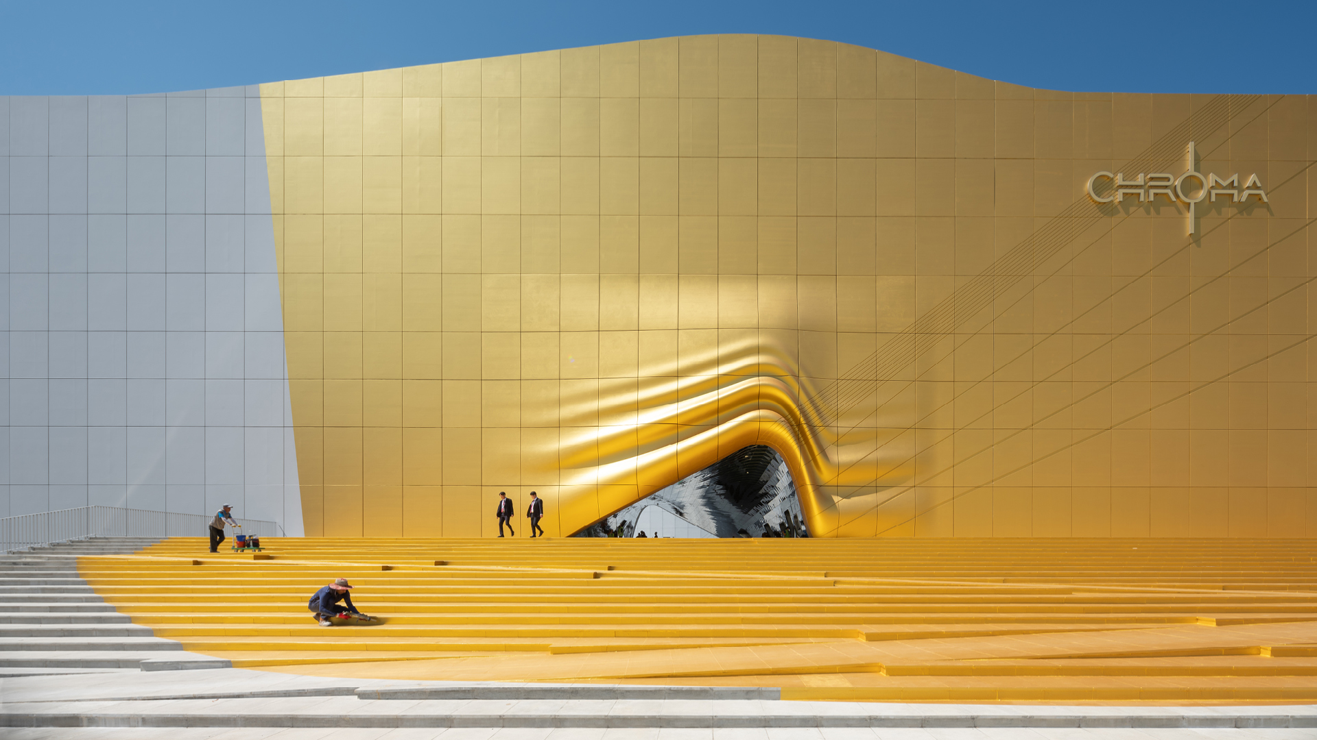 The entrance to The Imprint appears as if it were lifted like a curtain while a gold spotlight were lighting up its steps | Façade Round up 2019 | STIRworld