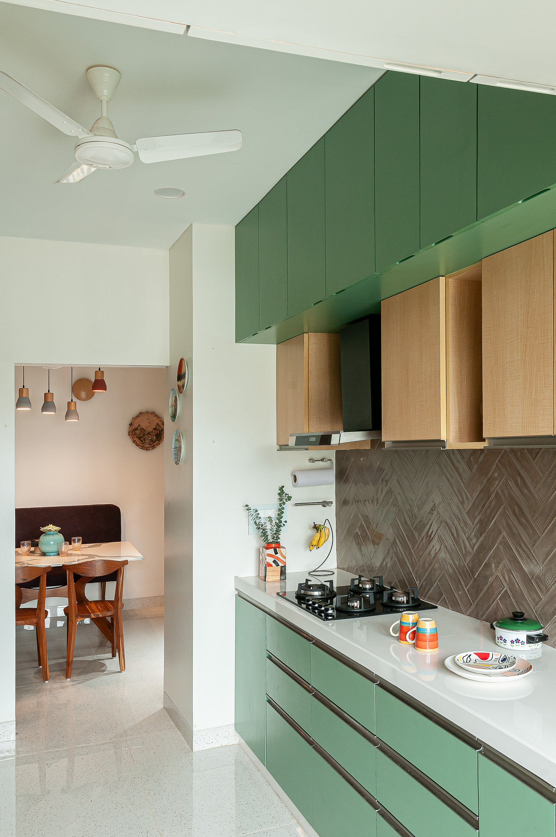 The 'green' open kitchen that allows eye contact with the dining space |Through the Keyhole Arches |MuseLAB| STIRworld