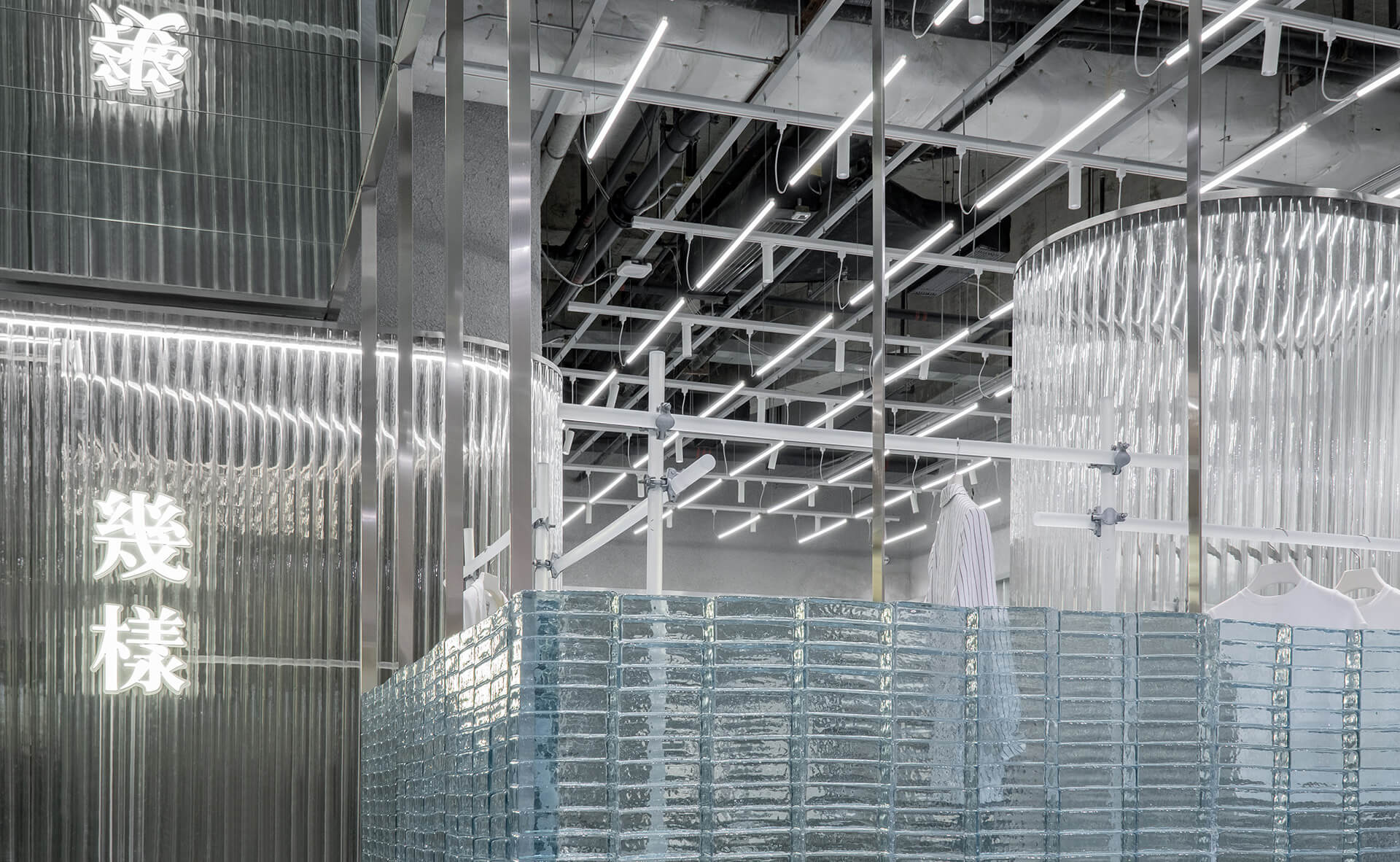 Exposed grid ceiling and half glass brick walls forming the interiors | Geijoeng Concept Store | Studio 10 | STIRworld