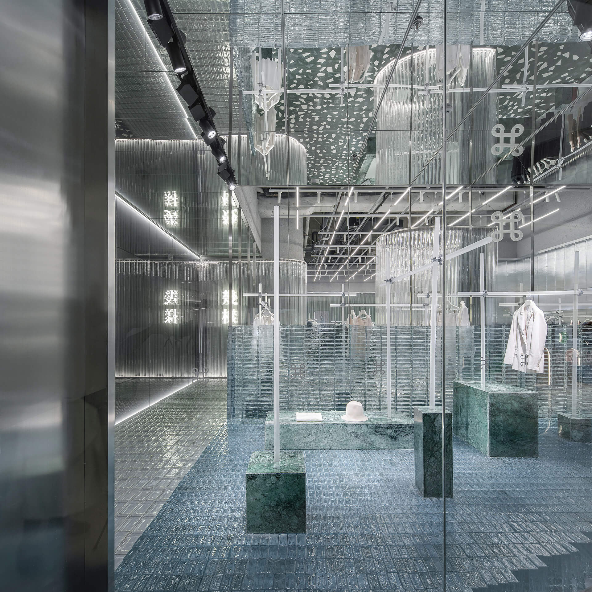The interiors explore the weightlessness of glass and its interaction with light | Geijoeng Concept Store | Studio 10 | STIRworld