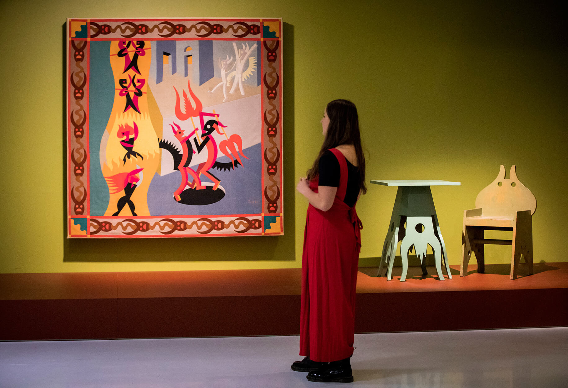 A tapestry and chair designed by Fortunato Depero for Cabaret del Diabolo, Rome | Into the Night: Cabarets and Clubs in Modern Art | Barbican Centre | STIRworld