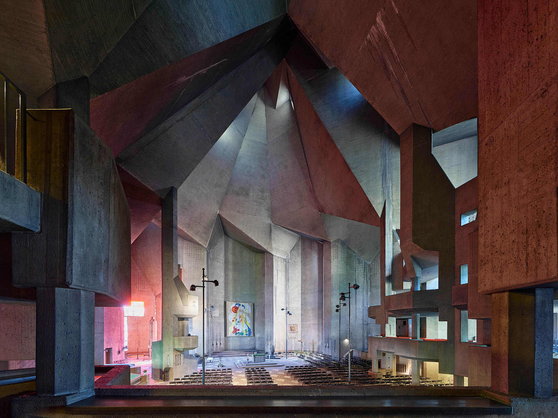 The jagged, amorphous volume of the church and its cavernous interiors connect with the mountaineous terrain of the region | BÖHM100: The Concrete Cathedral of Neviges | Deutsches Architekturmusem (DAM) | STIRworld