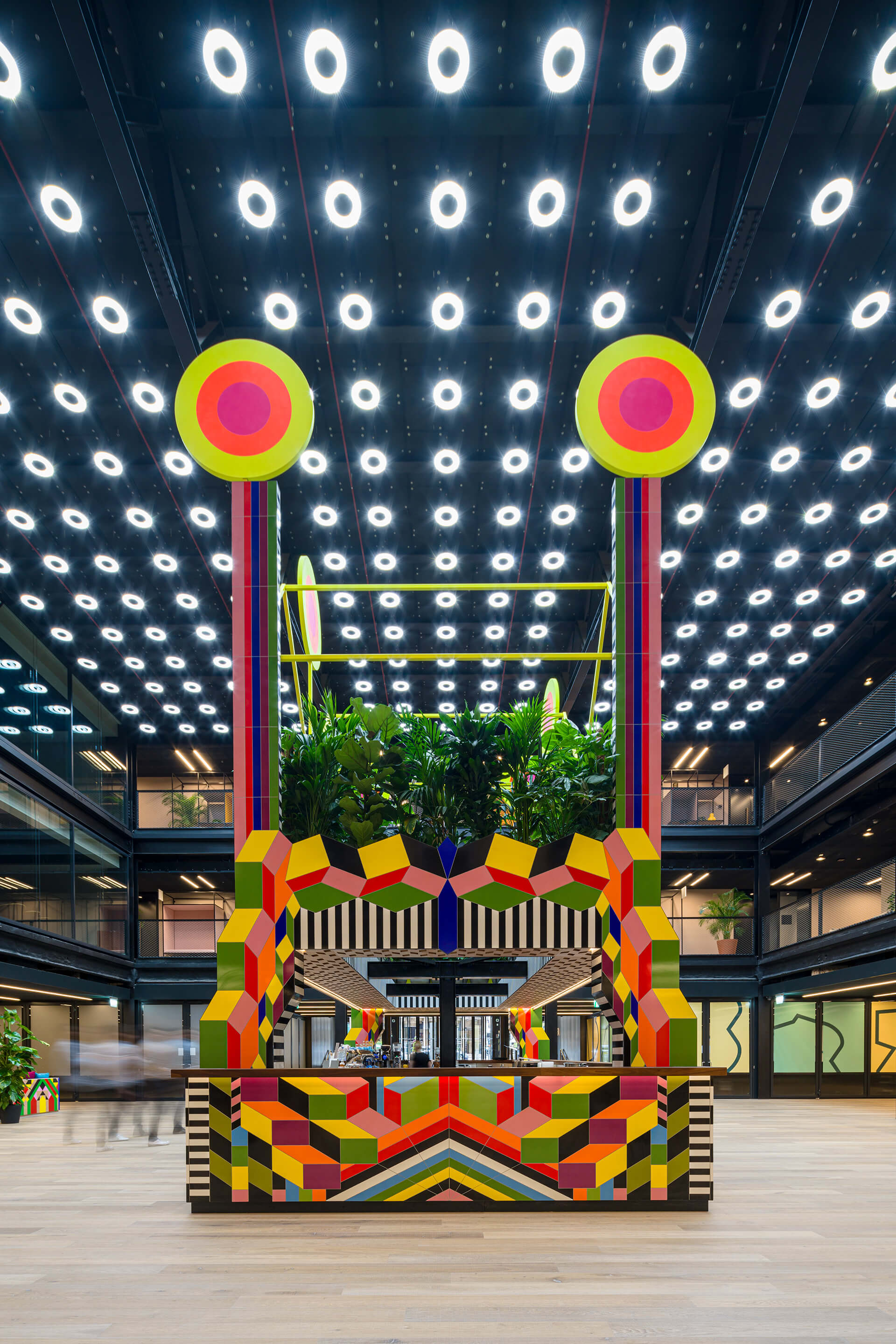 The colourful centerpiece is a biophilic installation that houses a café | Atoll | Morag Myerscough |STIRworld