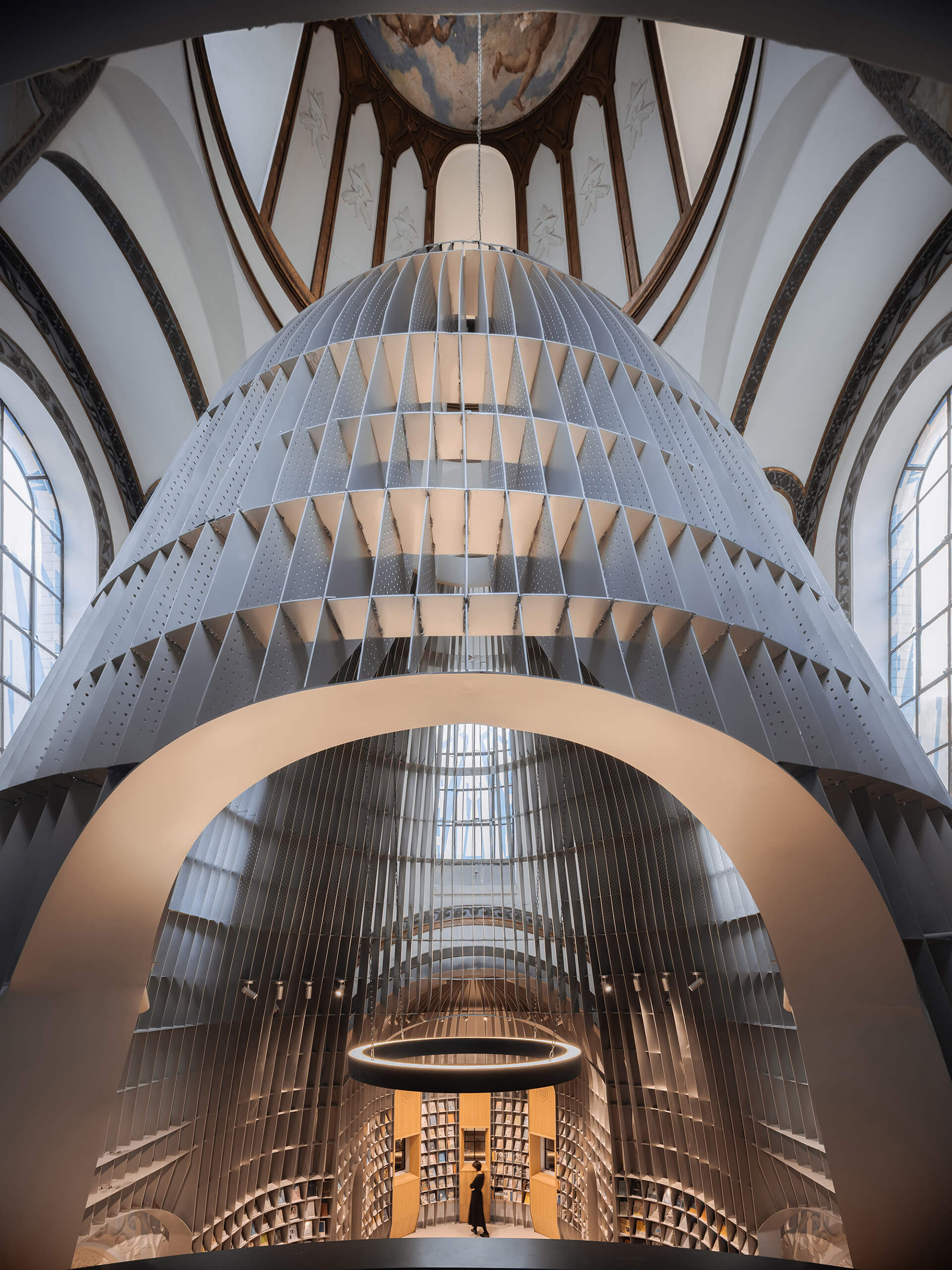 An enormous framework of steel was inserted within the former church | Sinan Books Poetry Store by Wutopia Lab | STIRworld