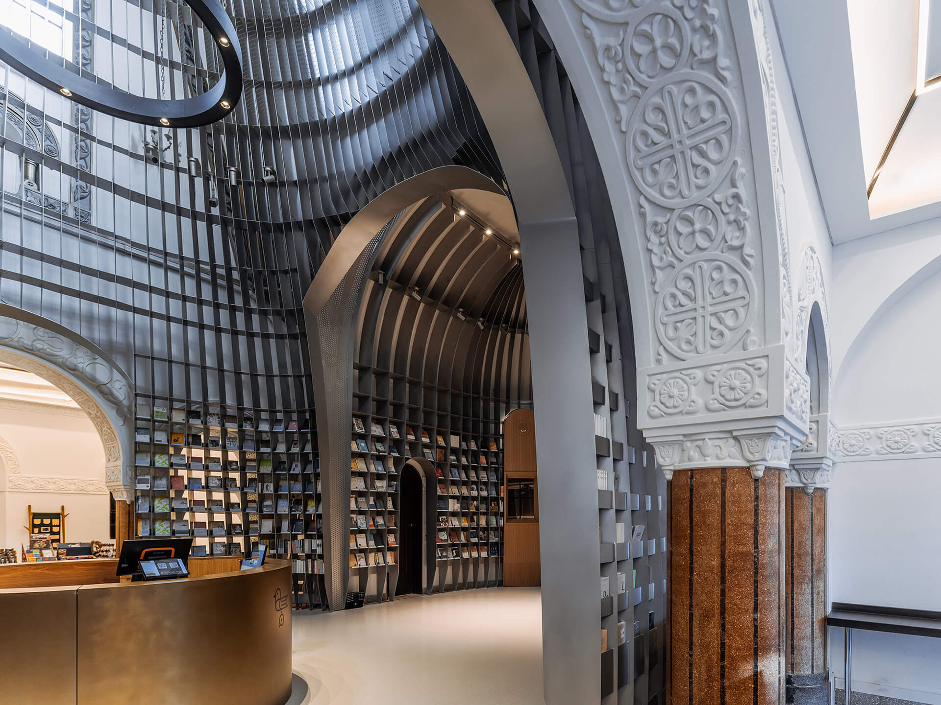 The inserted steel framework leaves a gap of 50 cm from the old walls of the church | Sinan Books Poetry Store by Wutopia Lab | STIRworld