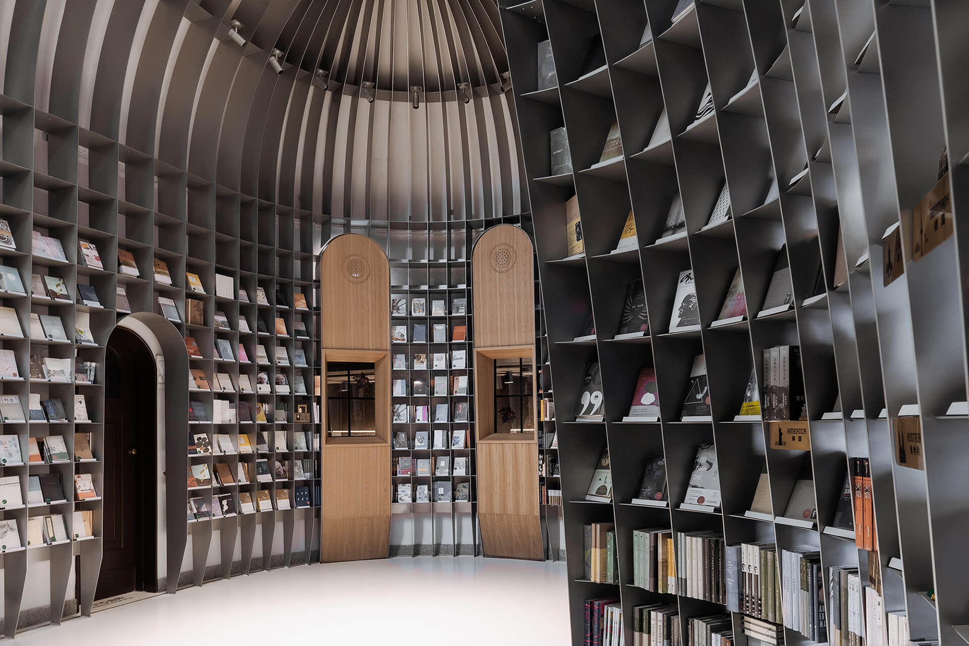 Wutopia Lab inserted a stunning steel framework inside, forming the bookstore's sanctuary | Sinan Books Poetry Store by Wutopia Lab | STIRworld