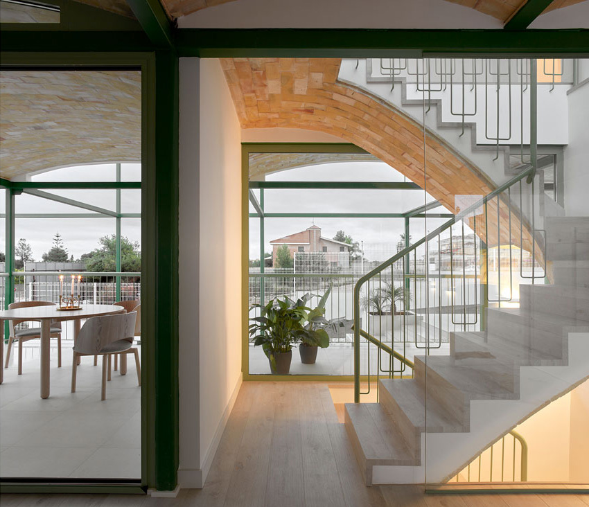 Wide openings overlooking the neighbourhood frame the interior walls  | Brick Vault House | Space Popular | STIRworld