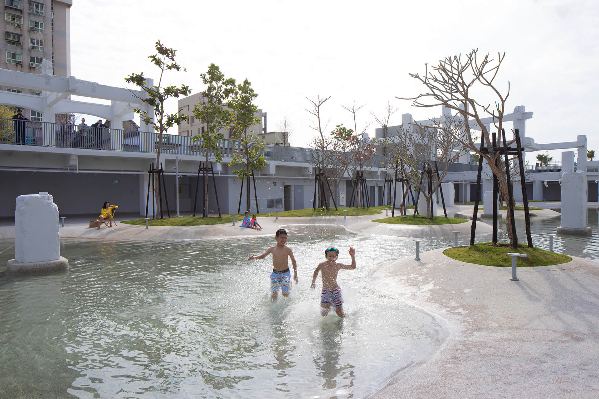 In Tainan Spring, people can bathe in the overgrown remains of a shopping mall | MVRDV's Tainan Spring is an urban lagoon in Tainan, Taiwan | STIRworld