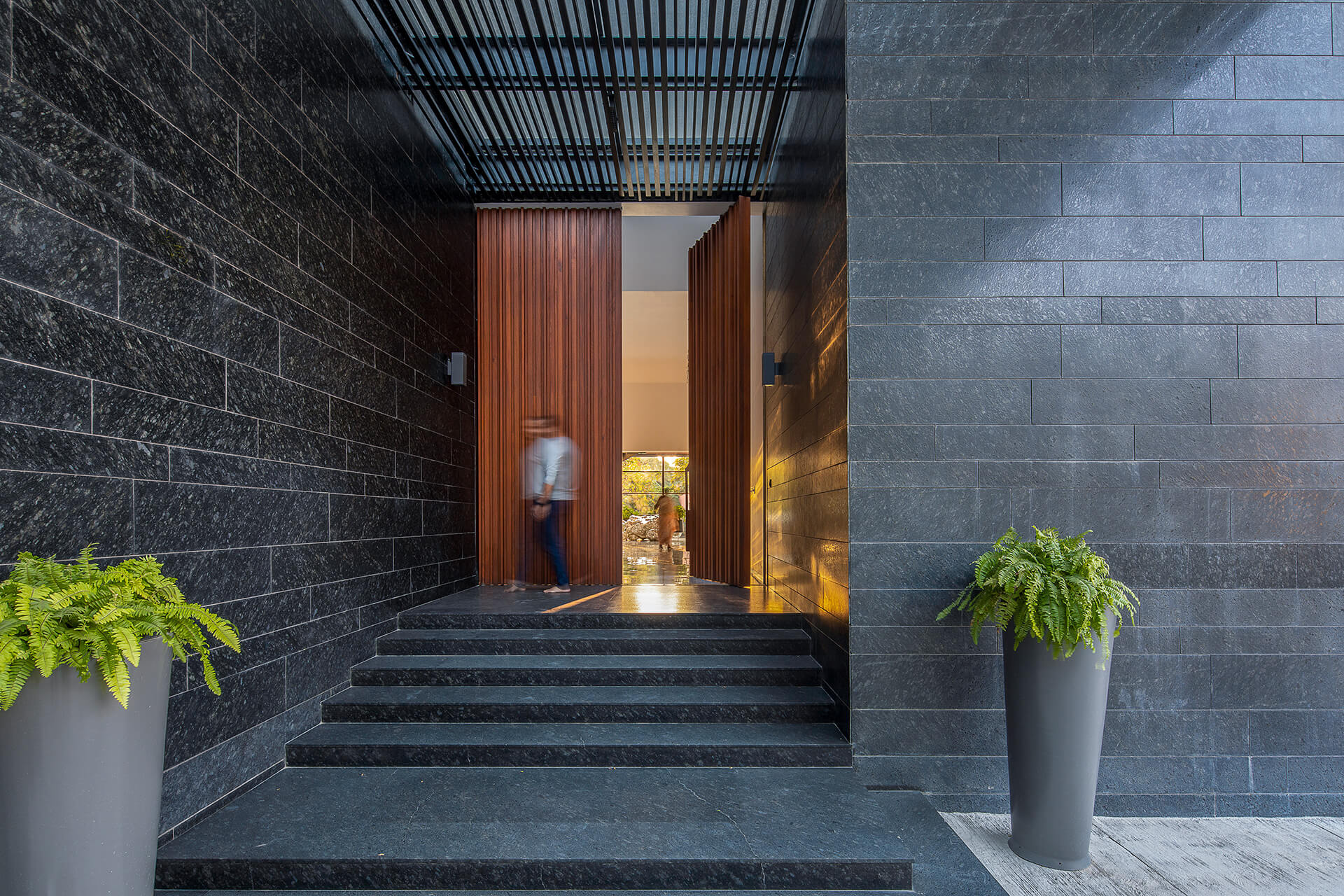 Entrance to the house shows contrast of materials | Black Bastion House | Spasm Design | STIRworld