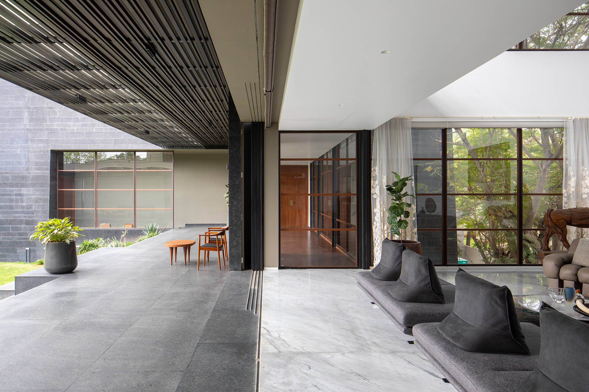 A double-height living area overlooking the central garden | Black Bastion House| Spasm Design | STIRworld