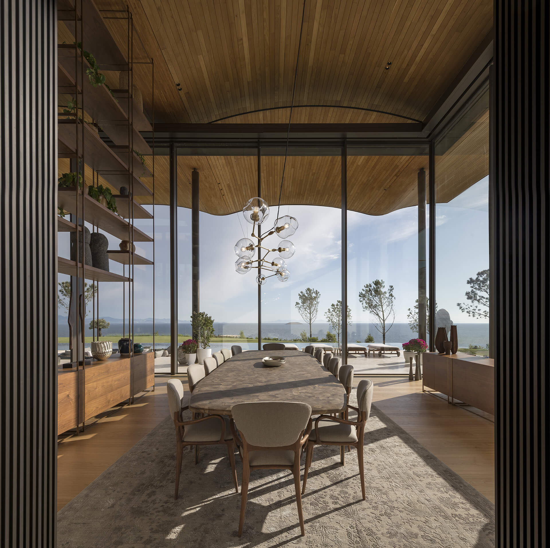 A common public space opening to the view of the Aegan Sea | Dolunay Villa in Mulga | Foster and Partners | STIRworld