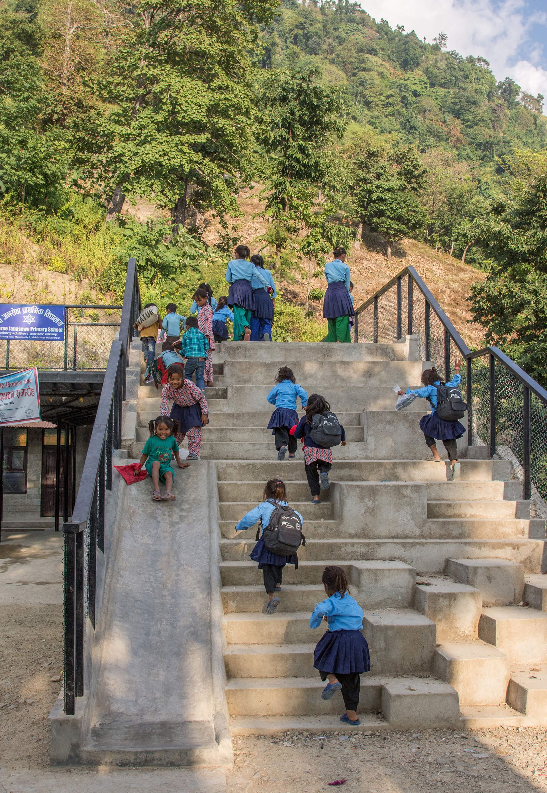 The girl students at the Shree Janasewa School by Sustainable Mountain Architecture | Anne Feenstra | Design after COVID-19| STIRworld