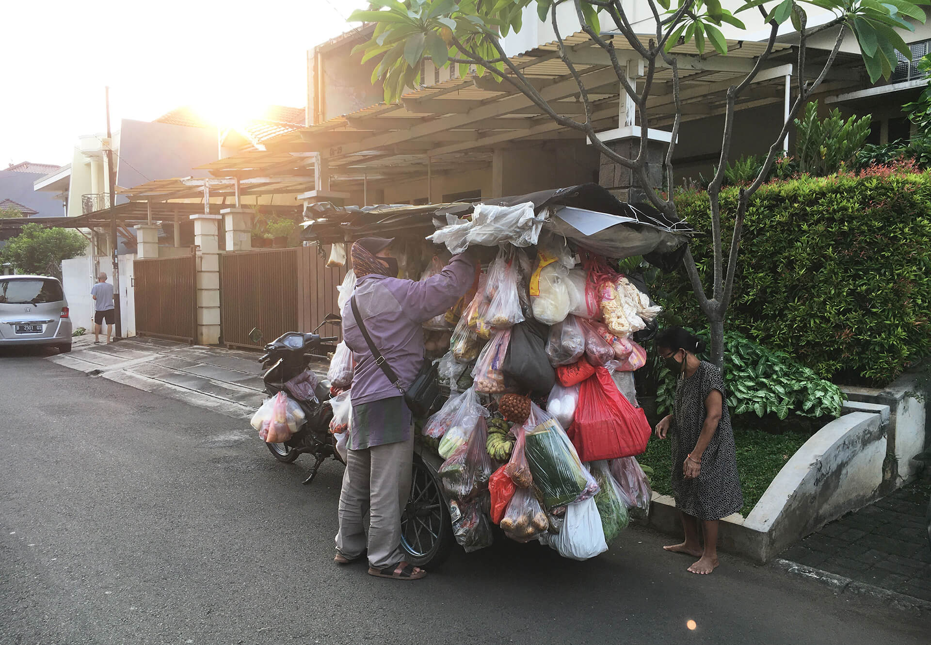 A local vendor selling vegetables in Jakarta during the pandemic | Rafael Miranti Architects | Design After COVID-19 | STIRworld