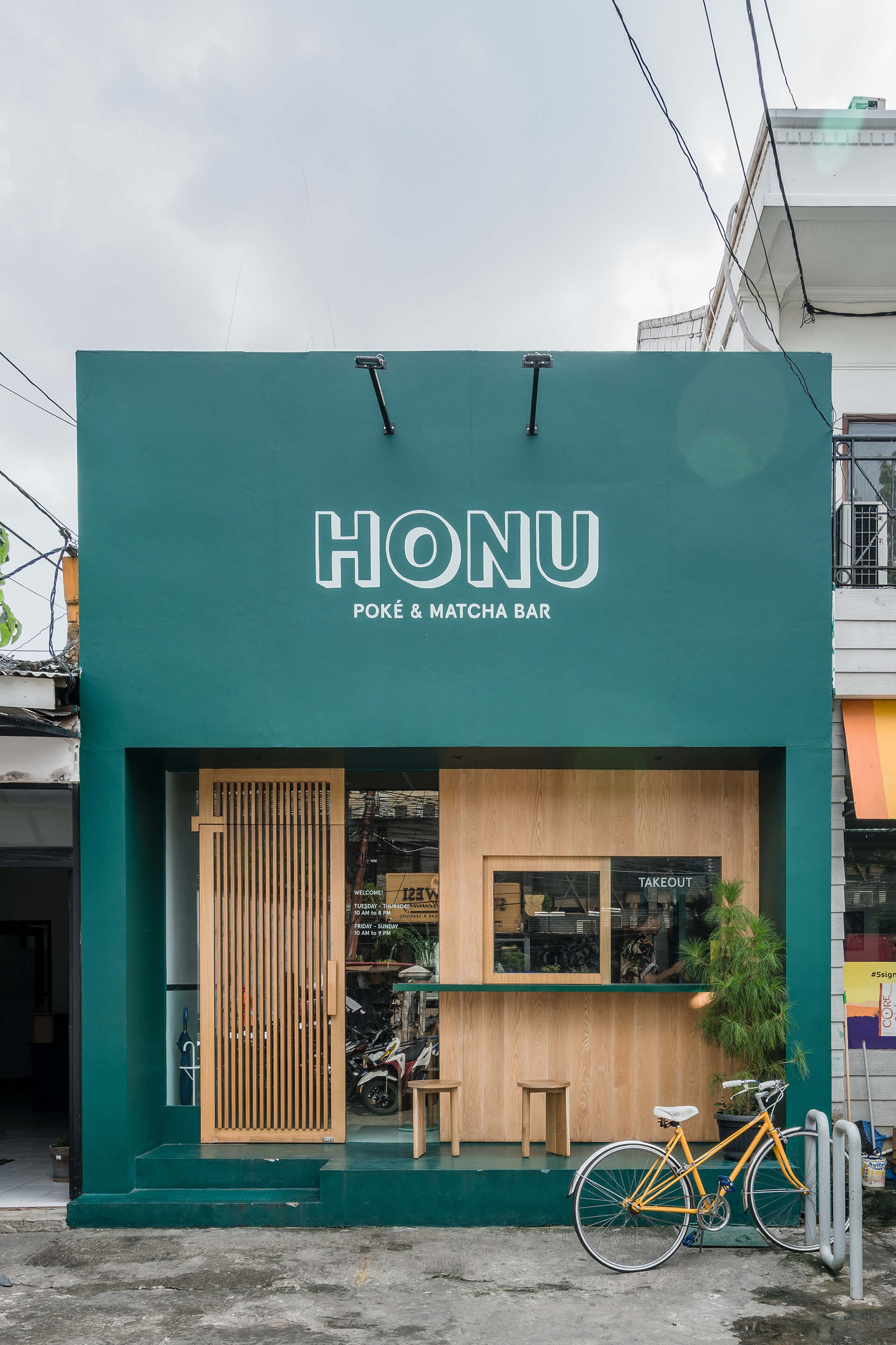 Honu Poke & Matcha Bar. Take out window as an integral part of the design. Project by Rafael Miranti Architects | Rafael Miranti architects  | Design After COVID-19 | STIRworld