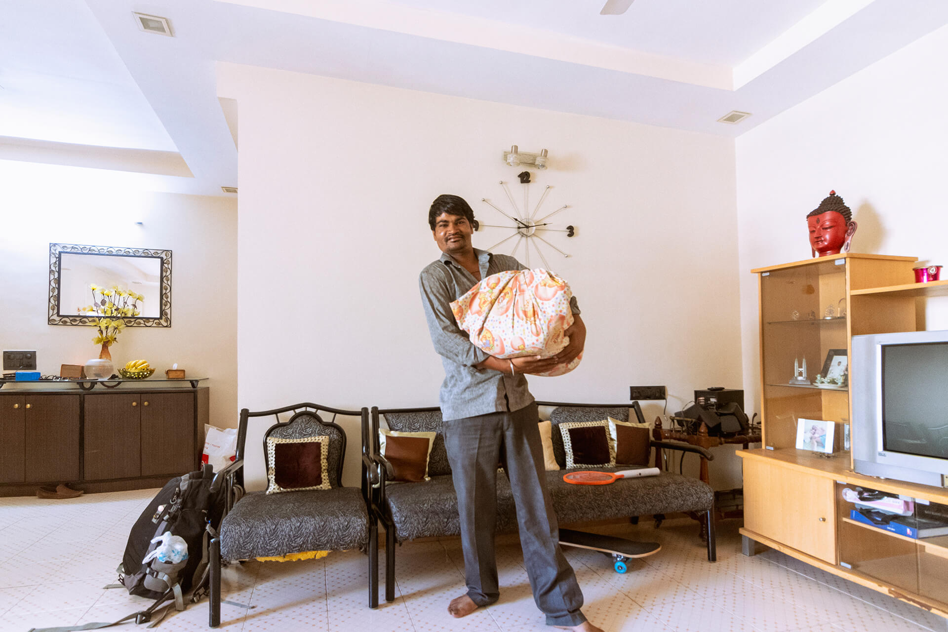 Dhanraj works as a dhobhi (launderer) in high-end apartments in Ahmedabad. Seeing a camera, he requested for a picture of him with the bag of un-ironed clothes he got from the household | Gated communities are destroying public life of Indian cities | STIRworld