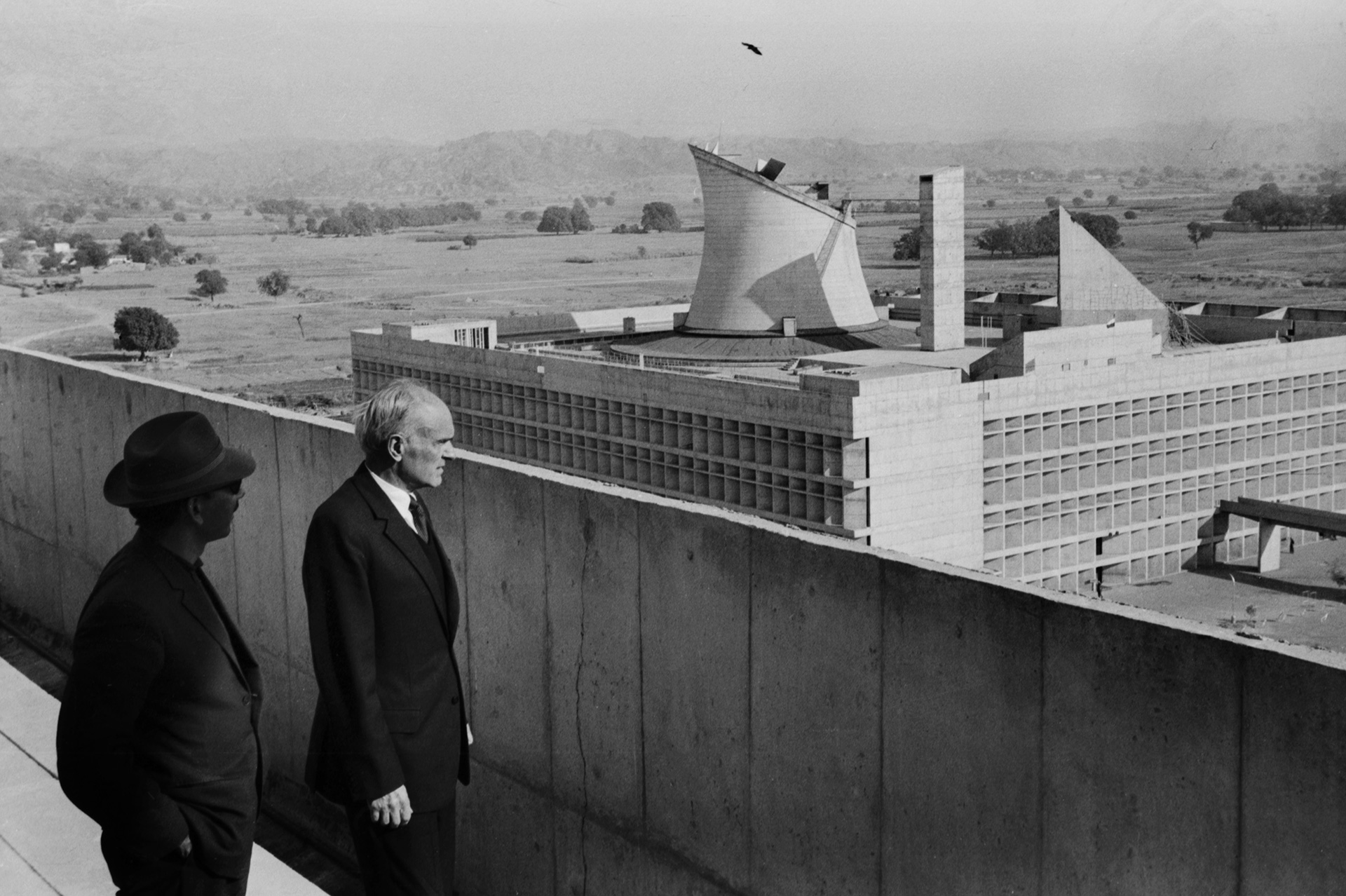 Philip Johnson looking at Le Corbusier's (then) recently completed Legislative Assembly building in Chandigarh; photographed by late Indian architect Habib Rahman, c.1965 | Peter Scriver | Frame conclave| STIR