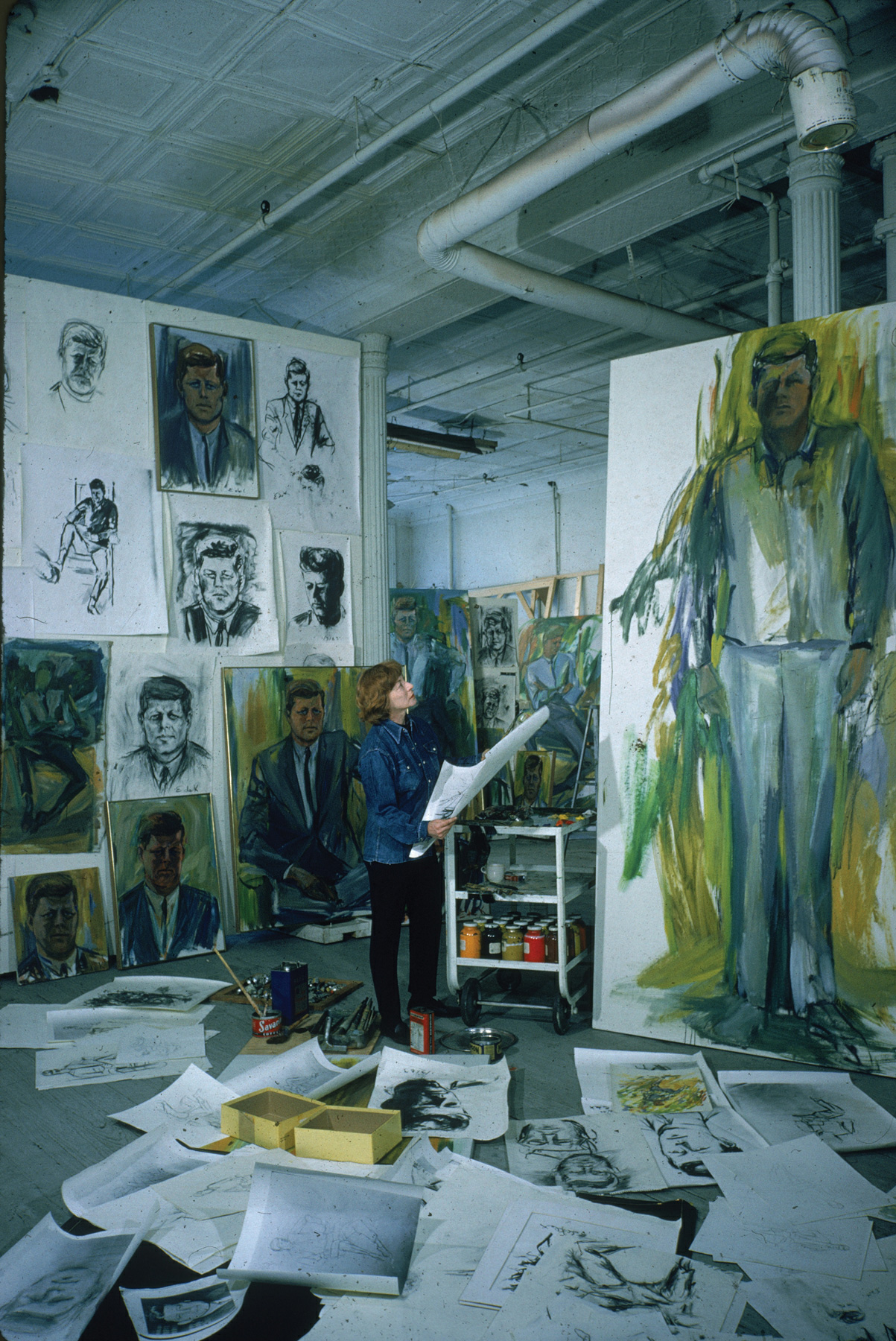 Elaine de Kooning in her studio with John F. Kennedy paintings, ca. 1963 | Ninth Street Women | Five Painters and the Movement That Changed Modern Art | Little, Brown and Company | Mary Gabriel | STIRworld