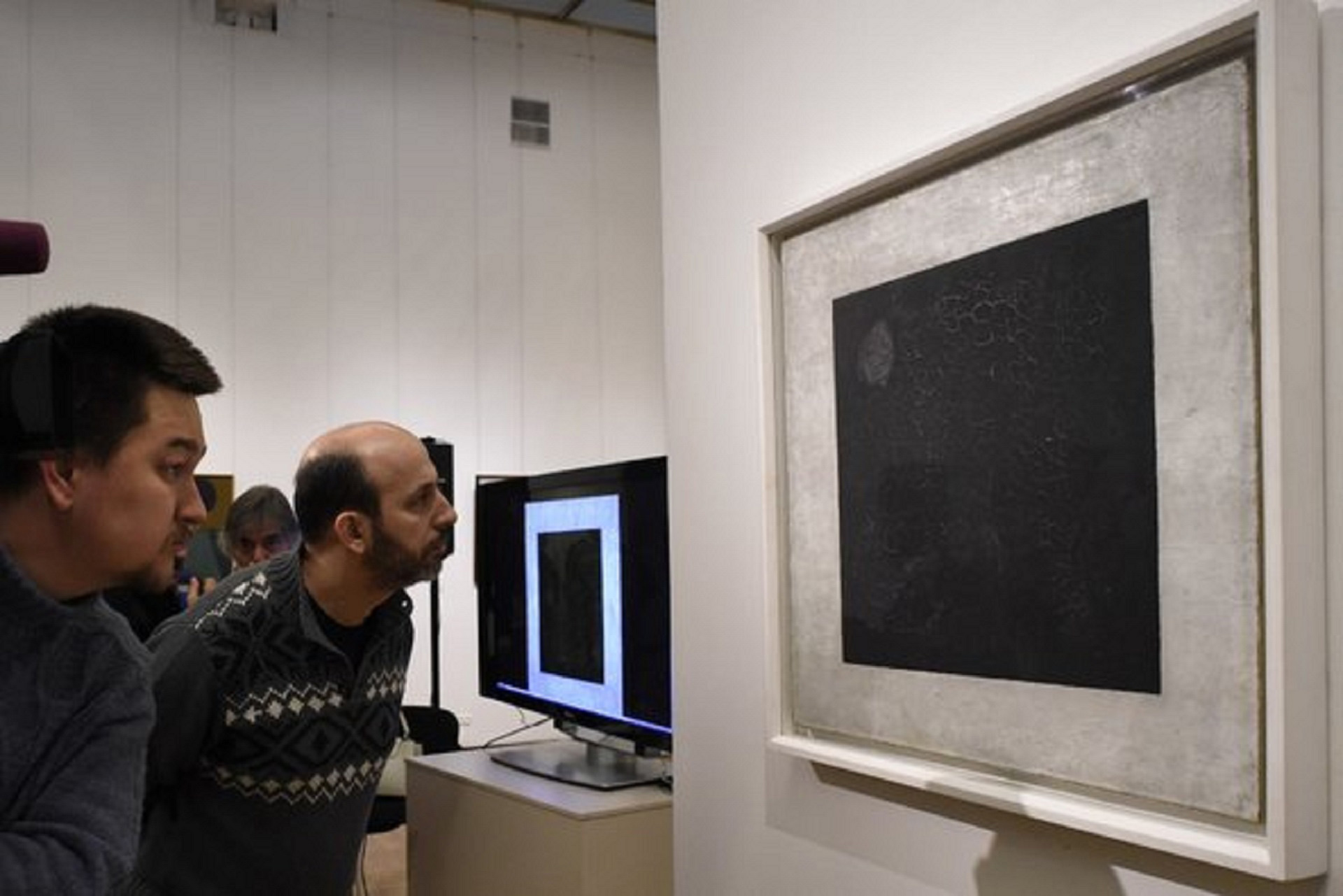 Researchers examine Kazimir Malevich's Black Suprematic Square in Moscow | Black Suprematic Square | Kazimir Malevich | STIRworld