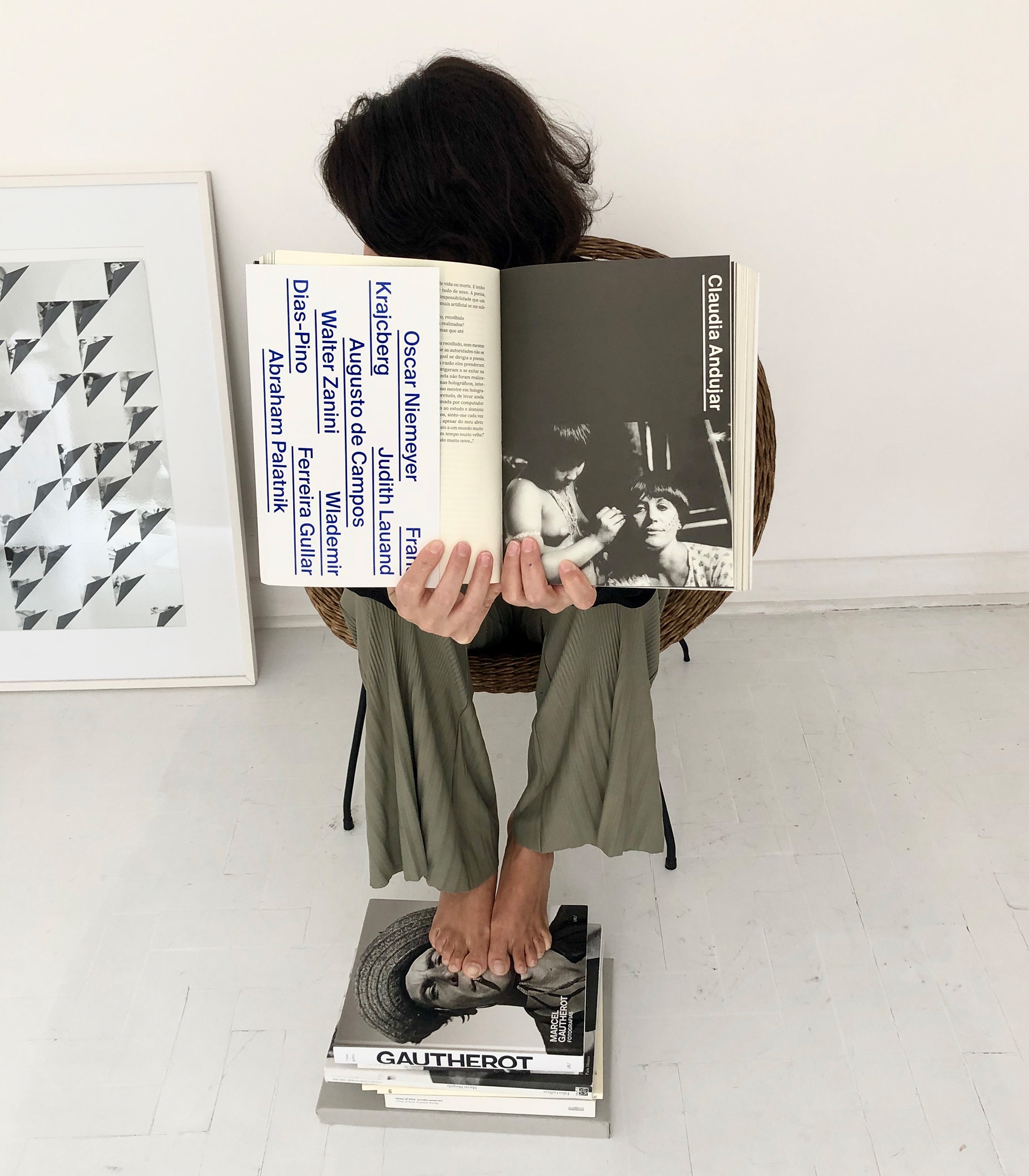 'Mariana Schmidt showing her pick, 'Entrevistas Brasileiras: Volume 1' by author Hans Ulrich Obrist | | What Am I Reading | Mariana Schmidt | Entrevistas Brasileiras: Volume 1| STIRworld
